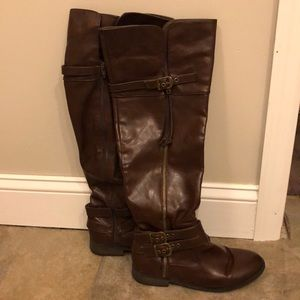 Over the knee or to the knee brown leather boots